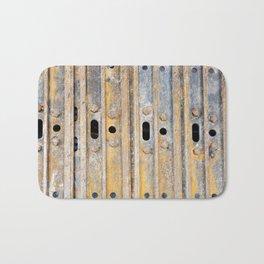 Rusty excavator caterpillar Bath Mat