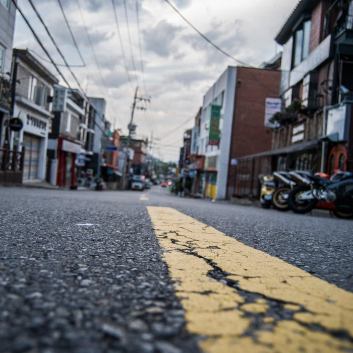 Freedom Village (Haebangchon) / Street-Level Comforters