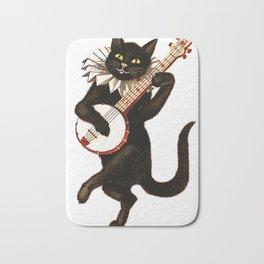 Cat playing a banjo Bath Mat