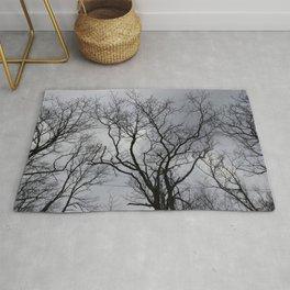 Black naked trees, creepy forest Rug