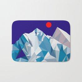 Snowy mountain, red sun Bath Mat