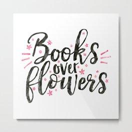 Books over flowers Metal Print
