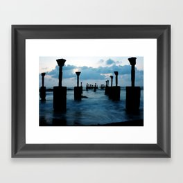 Pillars by the sea Framed Art Print