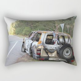 Burnt out car on a deserted road Rectangular Pillow