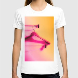 wood hanger with pink and orange background T-shirt