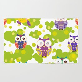 bright colorful owls and green leaves on white background Rug