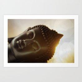 The silhouette of a Buddha head in Sunrise Art Print