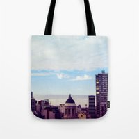 skyline Tote Bags featuring skyline by Maria Ostapchuk