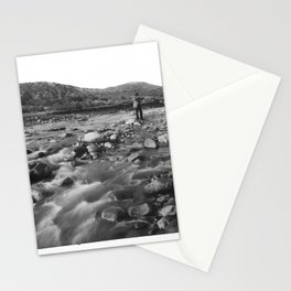 Man with rifle stands in mountain stream as it floods, east of Palmdale, California, ca.1920 Stationery Cards