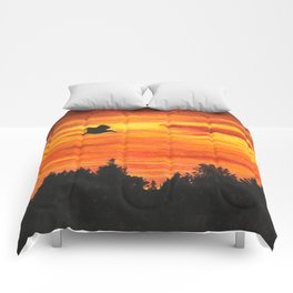 Sunset sky with bird Comforters