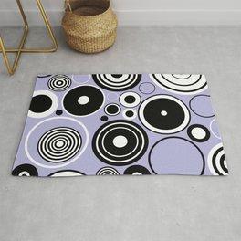 Geometric black and white circles on pastel blue Rug