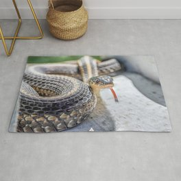 Garter snake with its tongue out Rug