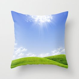 Green field and blue sky a sunny day Throw Pillow