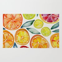orange Area & Throw Rugs featuring Sliced Citrus Watercolor by Cat Coquillette