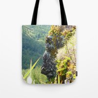 no face Tote Bags featuring Face by SnowInSeptember
