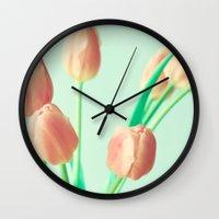 pushing daisies Wall Clocks featuring Gravity's Pushing by Caroline Mint