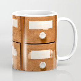 Backgrounds and textures: very old wooden cabinet with drawers Coffee Mug