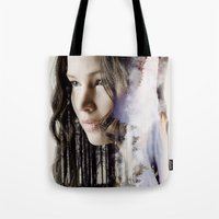 katniss Tote Bags featuring katniss by phoebe-designs