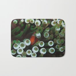 Maroon Anemonefish resting in its green anemone Bath Mat