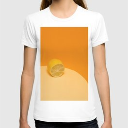 Cut fresh lemon on a yellow-orange background T-shirt