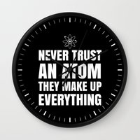 sayings Wall Clocks featuring NEVER TRUST AN ATOM THEY MAKE UP EVERYTHING (Black & White) by CreativeAngel