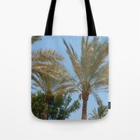 palm trees Tote Bags featuring Palm Trees by MehrFarbeimLeben