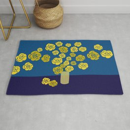 Yellow roses in vase on classic blue Rug