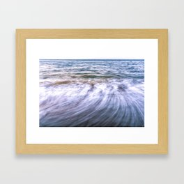 Waves and sand on the beach Framed Art Print