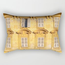 Beautiful facade old classic yellow building and antique windows and shutters on the street with blue cloudy sky. Vintage France street. Rectangular Pillow