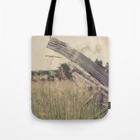 battlefield Tote Bags featuring Battlefield Fence by Sam Wesselhoft