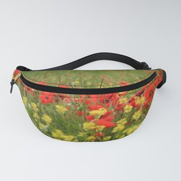 Red poppies on a background of yellow flowers and green grass. Fanny Pack
