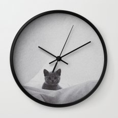 Kitten under the sheets Wall Clock