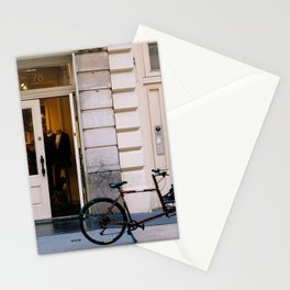 Old bicycle parked at luxury fashion store in New York Stationery Cards