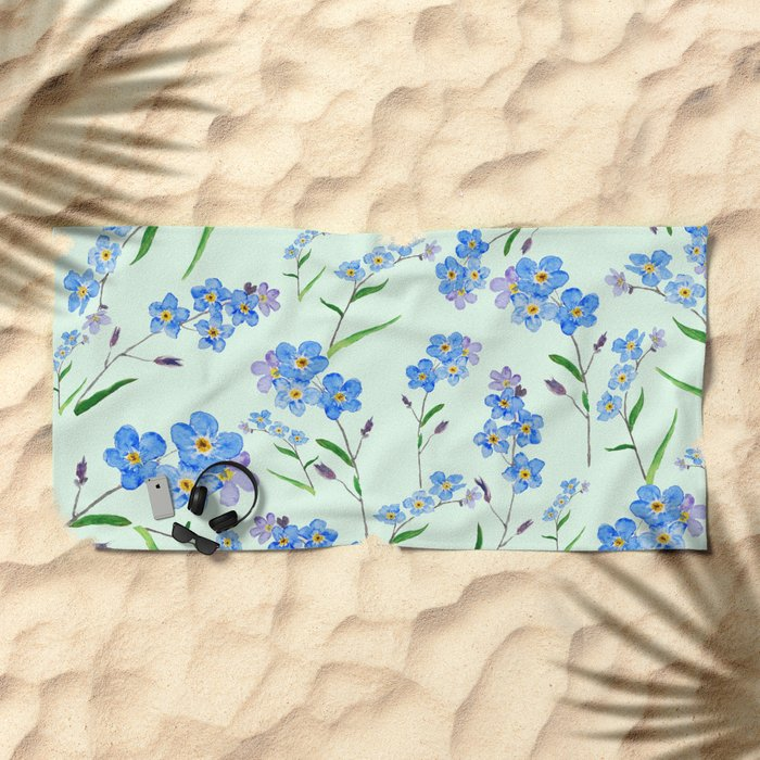 forget me not in green background Beach Towel