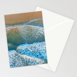 Looking down at ocean waves roll and crash into the shore at sunrise Stationery Cards