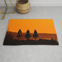 Wild West sunset - Cowboy Men horse riding at sunset Vintage west vintage illustration Rug