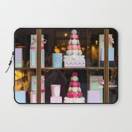 Beautiful colorful tasty macaroons cakes sweets and presents in the boxes display in window at the  Laptop Sleeve