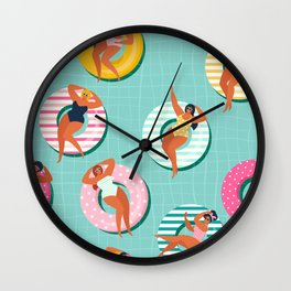 Summer gils on inflatable in swimming pool floats. Wall Clock