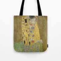 gustav klimt Tote Bags featuring The Kiss - Gustav Klimt by Elegant Chaos Gallery