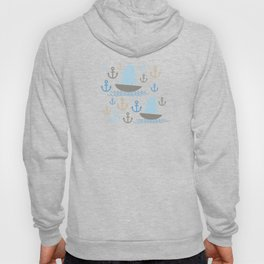 Light Blue background. Boat with white sails, sea anchor Hoody