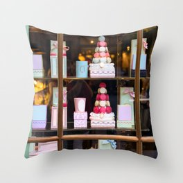 Beautiful colorful tasty macaroons cakes sweets and presents in the boxes display in window at the  Throw Pillow