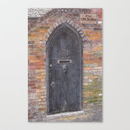 The Old Stables - Black wooden door with lion-head clapper Canvas Print