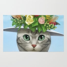 A cat wearing a flower hat Rug