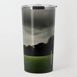 Football goalposts in an empty field Travel Mug