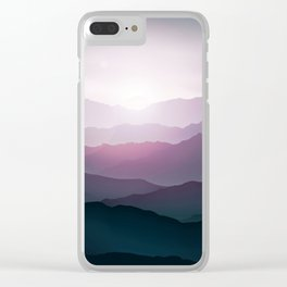 dark blue mountain landscape with fog and a sunrise and sunset Clear iPhone Case