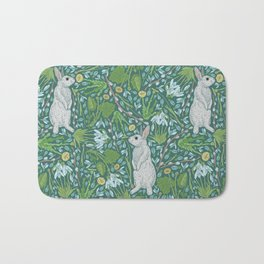 Grey hares with coltsfoots and snowdrops on green background Bath Mat