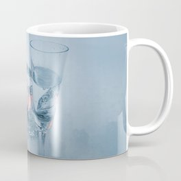 Two vodka shots and cyrstal tealight holder with burning tealight in snow close front view Coffee Mug