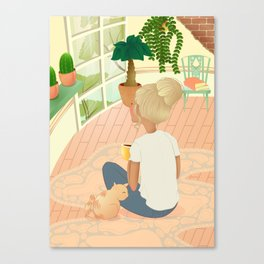 girl with cat relaxing at home looking out the window Canvas Print
