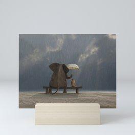 elephant and dog sit under the rain Mini Art Print