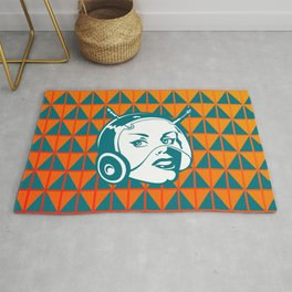 Faces: SciFi lady on a teal and orange pattern background Rug